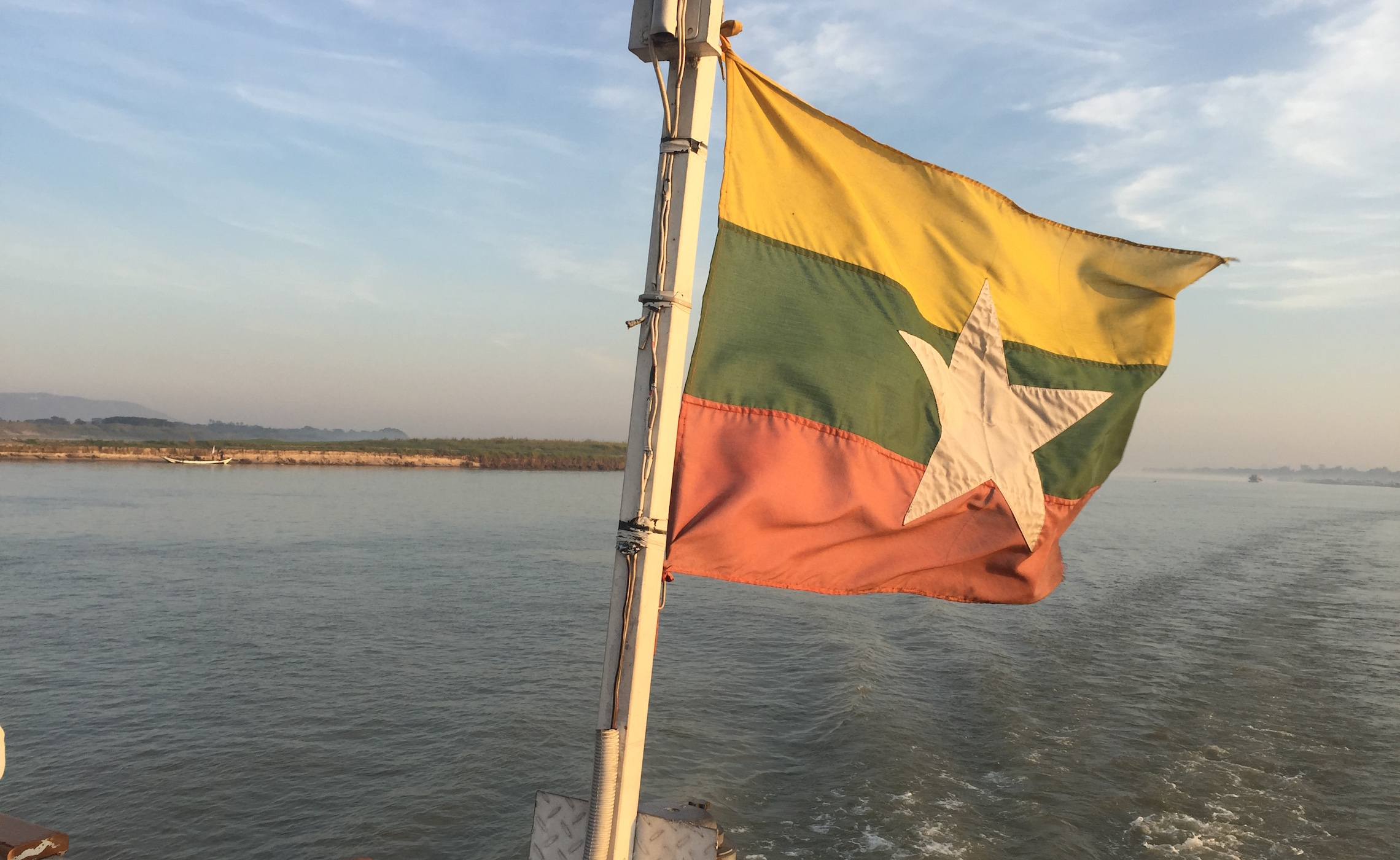 Myanmar Flag at the Back of the Boat