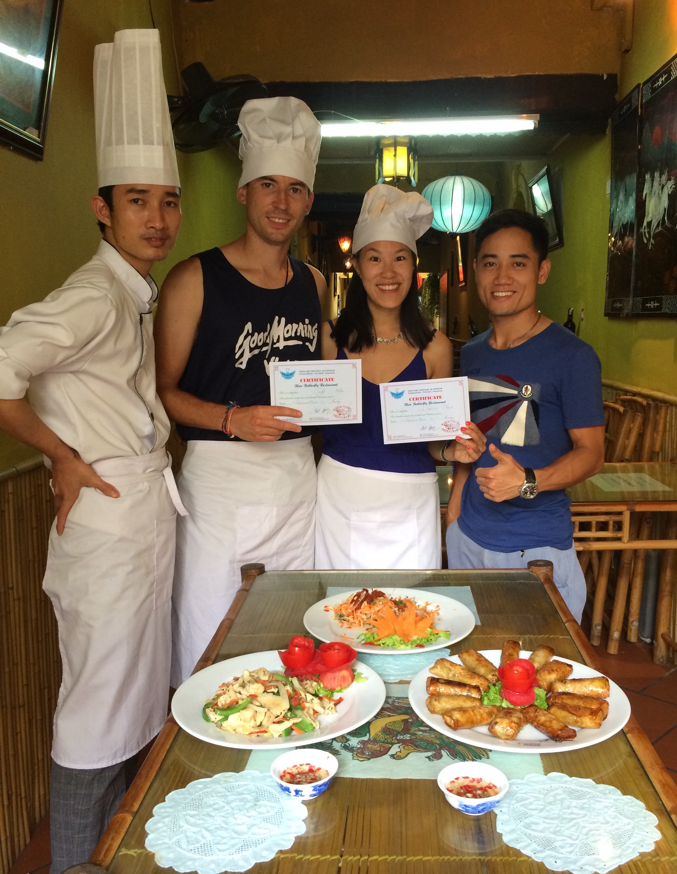 Photo at the end of our Blue Butterfly cooking class with our tour guide and chef teacher